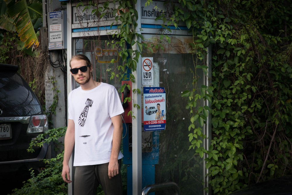 From Satoshi With Love Tee | Lean casually against phone booths | Contrast old and new revolutionary technologies